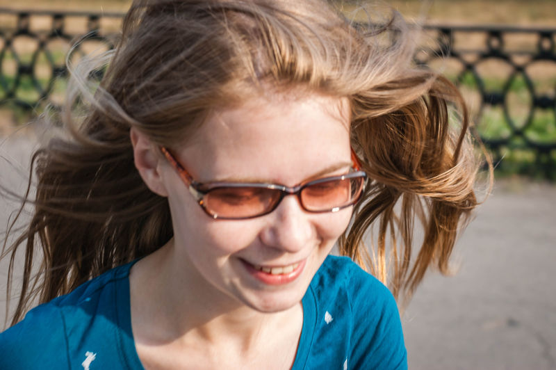 Close-up of teenage girl smiling