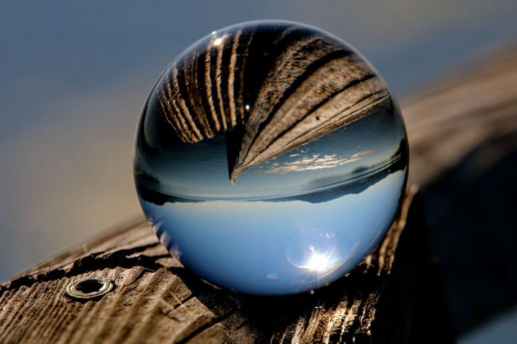 Close-up of crystal ball on wood