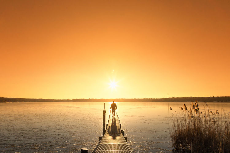 Hope Lonely Adult Beauty In Nature Full Length Future Horizon Over Water Jetty Leisure Activity Long Way Nature People Scenics Sea Silhouette Sky Standing Sun Sunlight Sunset Tranquil Scene Tranquility Two People Water Young Adult