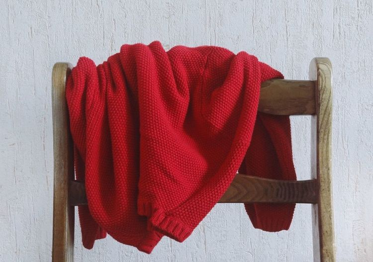 Sweater on chair against wall