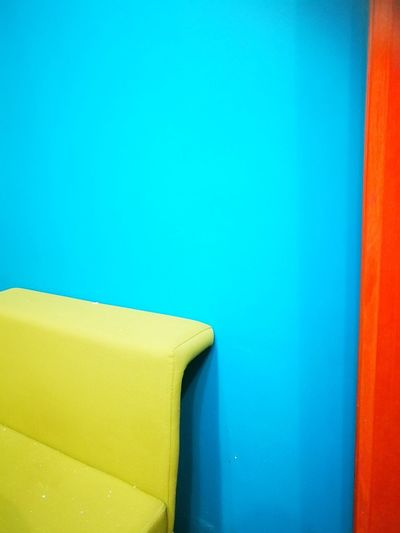 Pattern and color Multi Colored Blue Yellow Close-up Corner Wall - Building Feature Painted Paint Blue Background Brick Wall