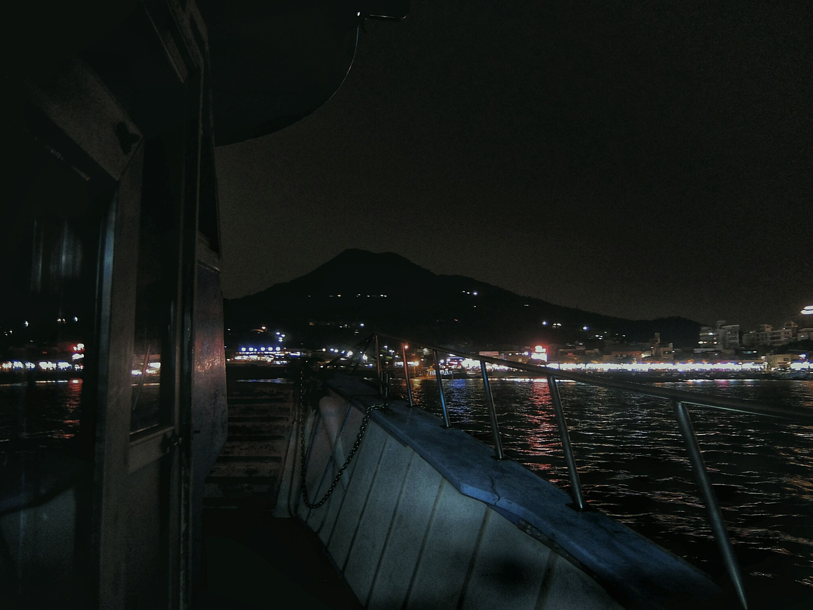 Boat in sea against sky at night