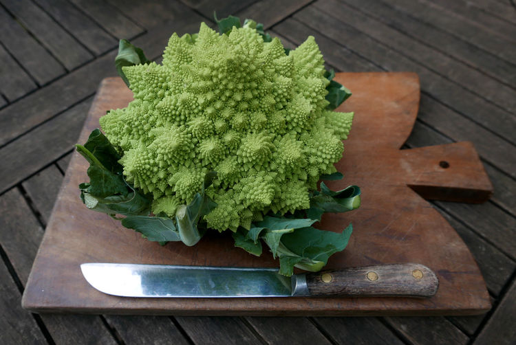High angle view of romanesco broccoli on cutting board