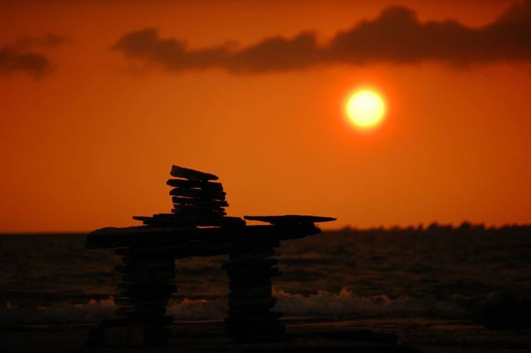 The Inuksuk watching the Sunset . Sunset Silhouettes Skyporn