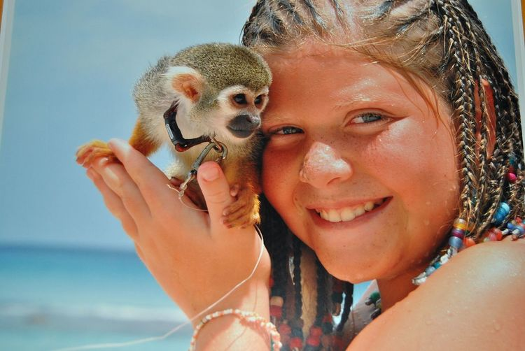 Close-Up Of Woman Holding Monkey
