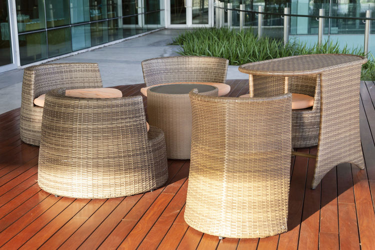 Modern Sofa and furniture. No People Day Chair Wicker Seat Outdoors Table Nature Architecture Wood - Material Sunlight Pattern Textile Retail  Stack Close-up Still Life Focus On Foreground Building Exterior Plant Furniture Furniture Design