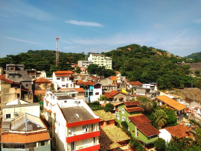 Cityscape of colourful houses and apartments surrounded by a tropical urban mountain forest. High Angle View Tree Outdoors No People Day Cloud - Sky City Travel Destinations Scenics Tropical Aereal View Mountain Urban Jungle Capital Cities  Nature Meets Urban Ecology Cityscape Residential Building Tourism Horizon Mountain Range Urban Skyline Brazilian Forest Capital Cities