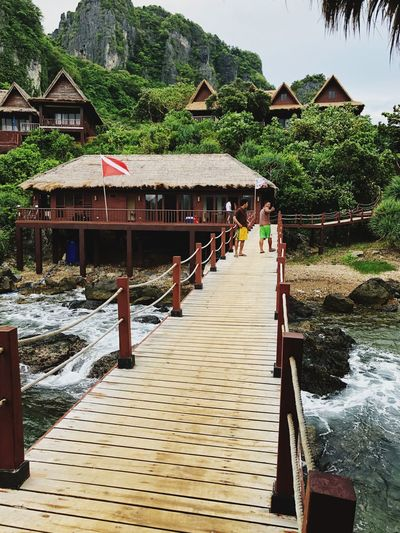 Bridge to paradise Mountain Bridge - Man Made Structure Leading Lines Architecture Built Structure Water Building Exterior Building Wood - Material The Great Outdoors - 2018 EyeEm Awards Tree House Nature Roof Stilt House Outdoors