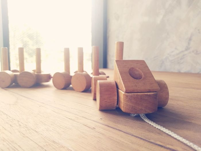 Close-up of toy vehicle on wooden table at home