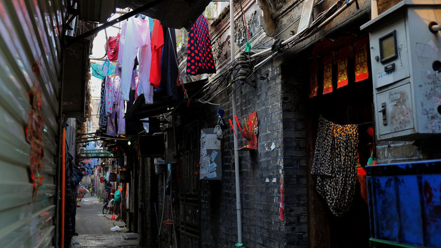 Follow me home, until it stands still. Downtown Migrant Workers Shenzhen Alley Ancient Village Architecture Building Exterior Built Structure China Cloth Clothesline Clothing Day Drying Hanging Migrant Migrant Village Multi Colored No People Textile Urban Urbanvillage Urbex