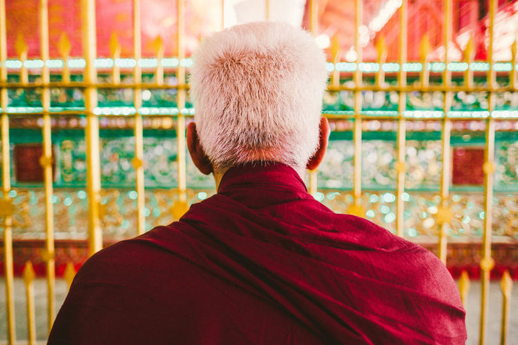 Rear View Of Senior Buddhist Monk