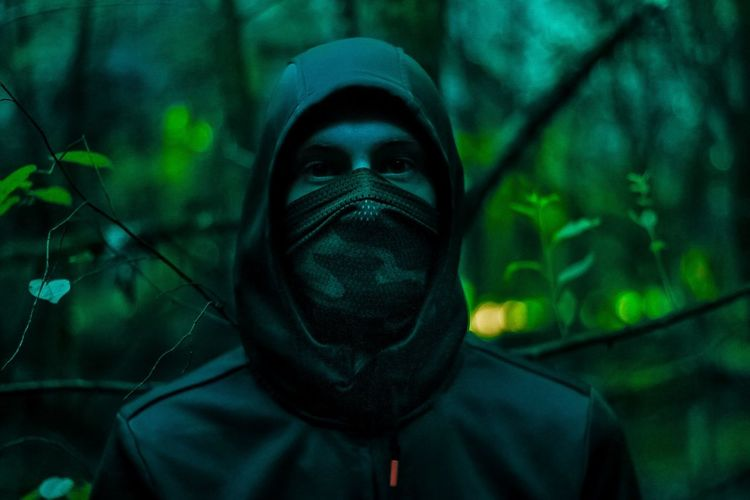 Close-Up Portrait Of Man Wearing Mask At Night