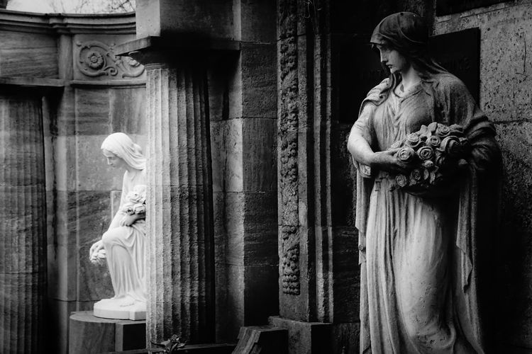 Female Sculptures At Cemetery