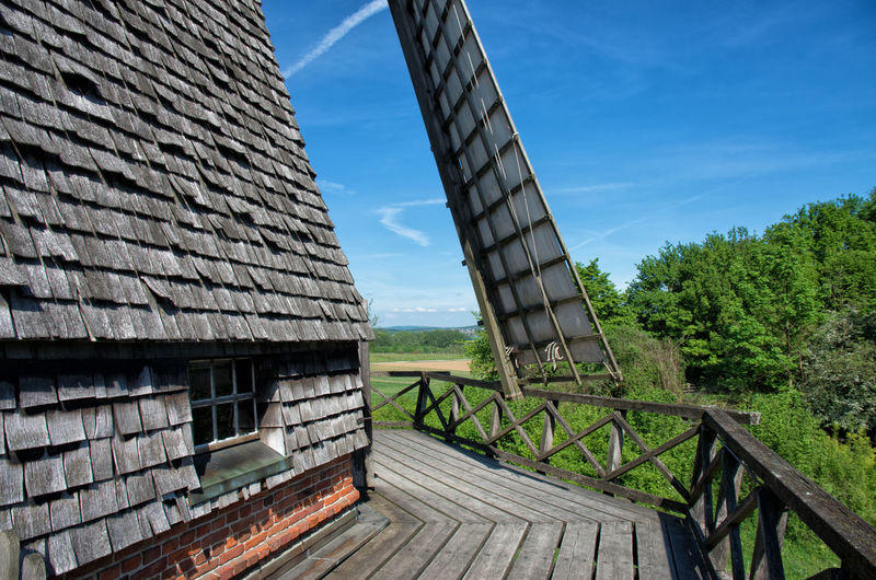 Historic Windmill in Germany Farm Life Wind Energy Windmill Architecture Building Exterior Built Structure Day Farming Flour Germany Historic Milling Old Outdoors Renewable Energy Rural Scene Shingles Shingles Beach Sky Wooden Wooden Architecture
