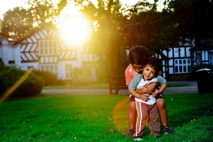 Brotherhood Bothers Brotherhood Love Family Childhood Outdoor Photography London Sunlight Full Length Two People Grass Holding Outdoors Tree Day Togetherness