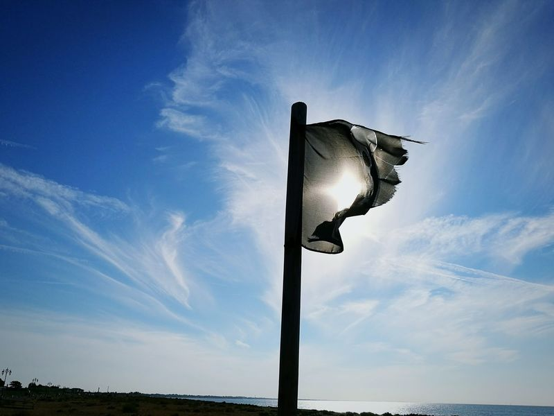 Sunshine At The Beach By The Sea Pirate Flag Jolly Roger Flagpole Silhouette Blue Sky Beautiful Day Relaxing Cool