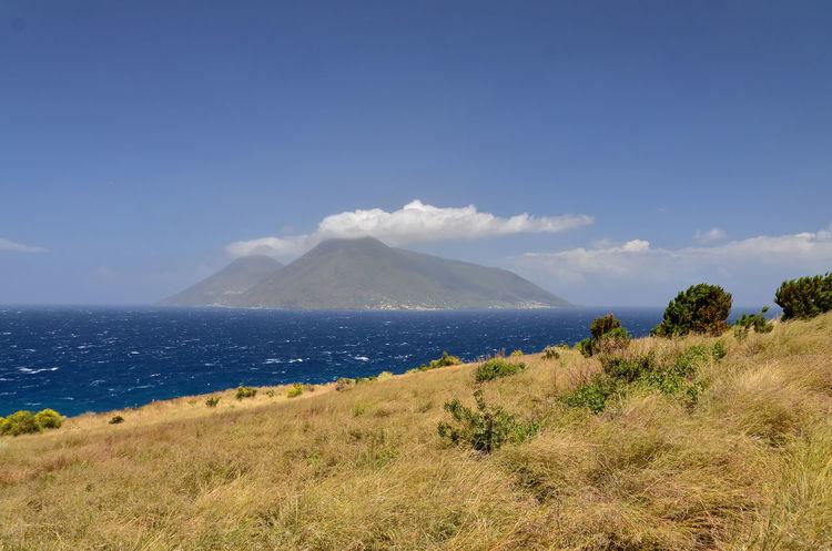 Beauty In Nature Blue Coast Coastline Day Landscape Lipari Lipari Island Mountain Nature No People Outdoors Plant Salina Island Scenics Sky Volcanic Landscape Volcano
