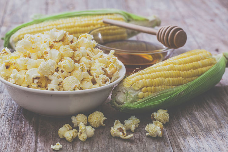 Woman with a gadget in hands staring out the window. Bowl Cooking Corn Earthenware Eat Food Homemade Hot Kinchen Pop Popcorn Prepare Rustic Seeds Snack Sweet Sweetcorn Vegetarian