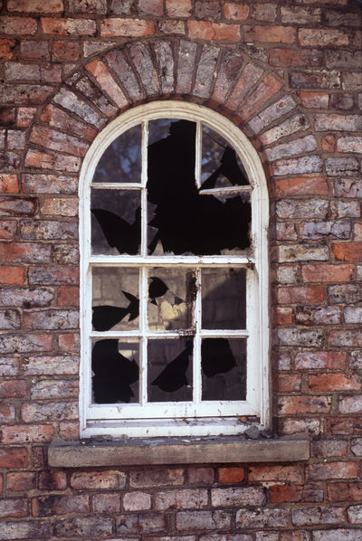 arched window with broken glass Abandoned Arch Brick Brick Wall Broken Building Exterior Damaged Derelict Glass Old Ruined Shattered Smash  Smashed Vandalised Window Wood