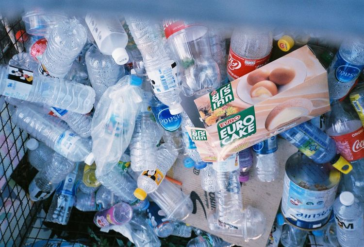 Close-up of hand holding plastic bottles