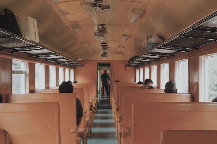 Rear view of people sitting in corridor