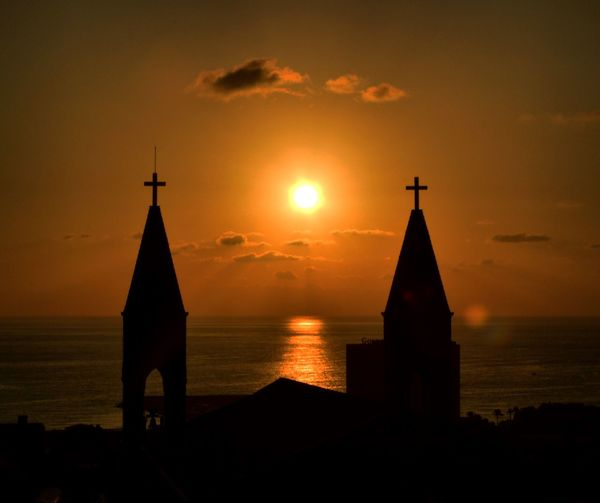 Sunset Spirituality Sun Religion Church Cross Sea Sky Beauty In Nature Tranquility Water