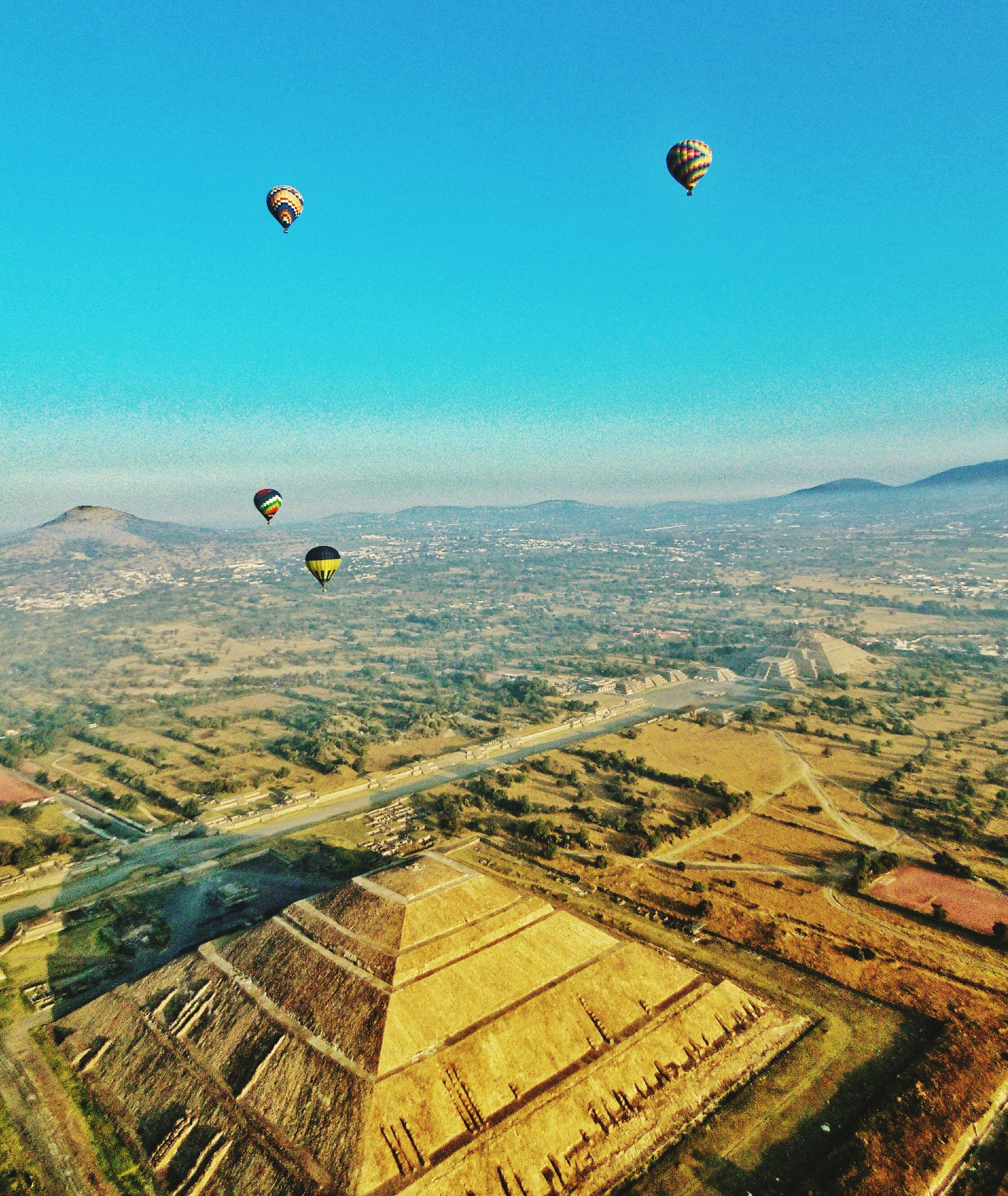 aerial view, hot air balloon, mid-air, flying, outdoors, sky, landscape, no people, full frame, nature, scenics, day, agriculture, backgrounds, drone, parachute