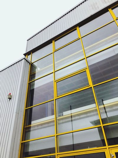 Architecture Low Angle View Built Structure Building Exterior No People Day Nature Sky Glass - Material Pattern Clear Sky Safety Outdoors City Sign Building Modern Reflection Yellow Protection