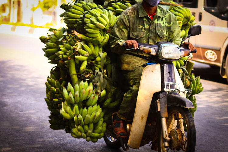 Hoian, Vietnam Travel Photography Travel Exceptional Photographs People Street Photography Defying Physics Rural Life Poverty But Happiness Drivers In Vietnam Street Vendor Bananas Green Bananas Selling Occupation Overloaded