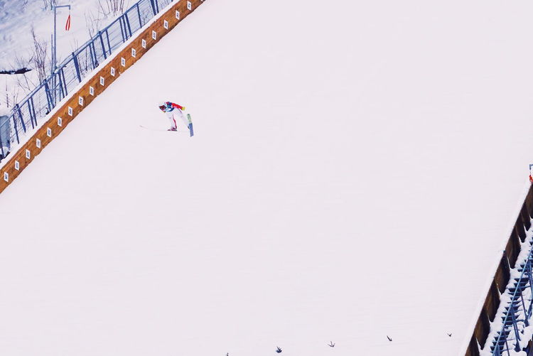 Snow Winter Copy Space Cold Temperature Sport Architecture Winter Sport Day Built Structure Nature Real People Sky Leisure Activity Men Lifestyles High Angle View Building Exterior Full Length One Person Snowing Skiing Minimalism