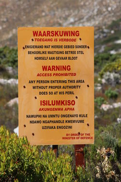 Cape Town DISUSED South Africa Xhosa Afrikaans Close-up Communication Day Focus On Foreground Military Mountain Nature Naval Base No People Outdoors Plant Prohibited Redhill Simons Town Text Warning Sign Western Script