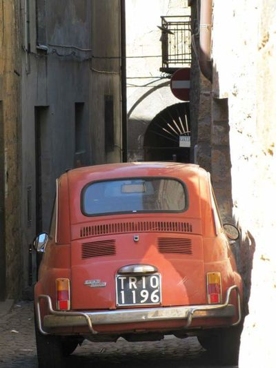Bumper to bricks Italy Cute Red Car How Do They Park Like That Vintage Fiat 500 San Gimignano