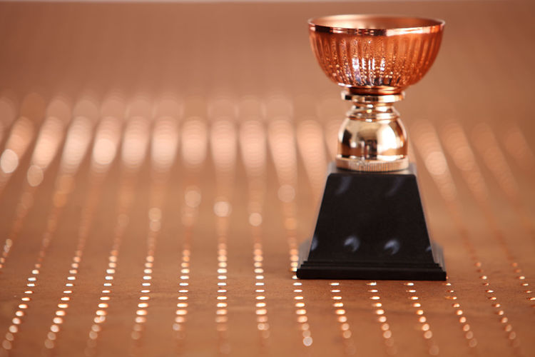 Close-up of trophy on table