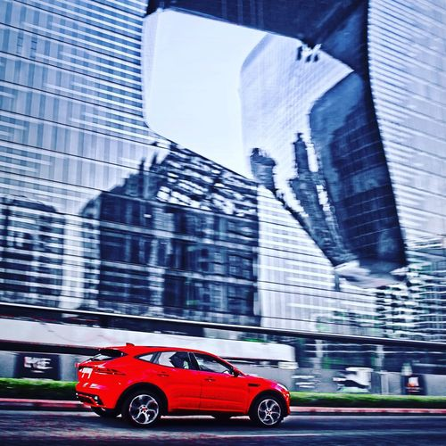 Jaguar E-Pace bringing colour to the urban jungle! Action Dubai Automotive Photography Urban Skyline Jaguar E-Pace Architecture Building Exterior Built Structure Mode Of Transportation Transportation Car Motor Vehicle City Red Building No People Outdoors Motion Road Office Building Exterior Street