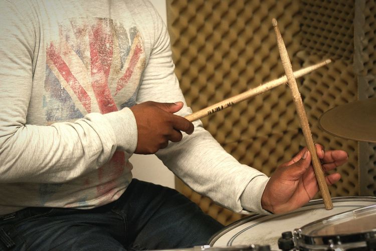 Drummer in rehearsal Studio preparing for upcoming festival. Musician Reggae Music Musical Instrument Drumming Drummer Rehearsal Studio Drums Hands Drumkit Drumsticks Drum Kit Drum Drumstick Drum - Percussion Instrument Performance Group