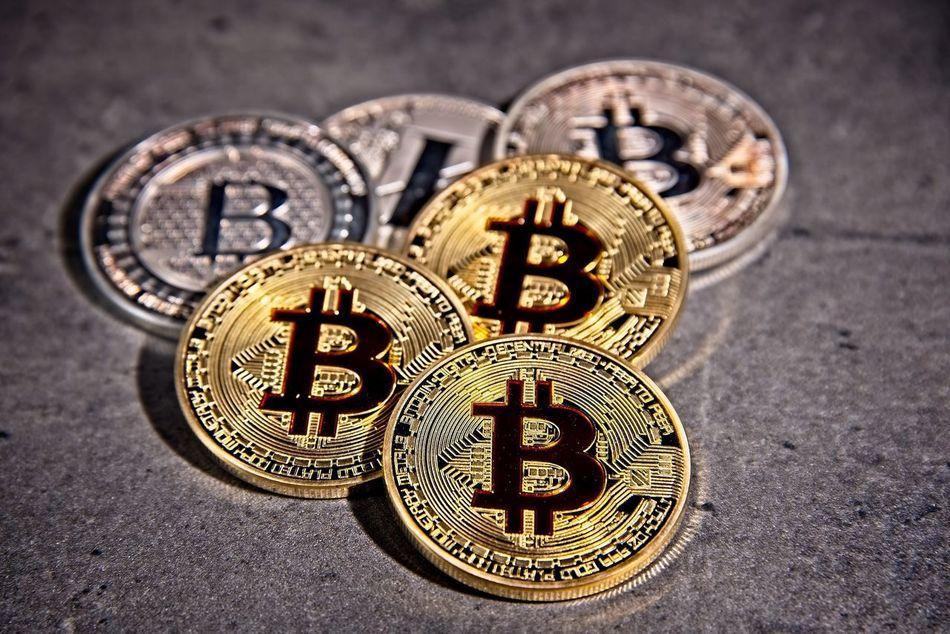 Shining metal BTC bitcoin coins on grey background. BTC Deep Web Economy Gold LTC Virtual Bitcoin Blockchain Close-up Coins Crypto Cryptocurrency Cryptography Dark Web Digital Finance Gold Colored Litecoin Money Trade