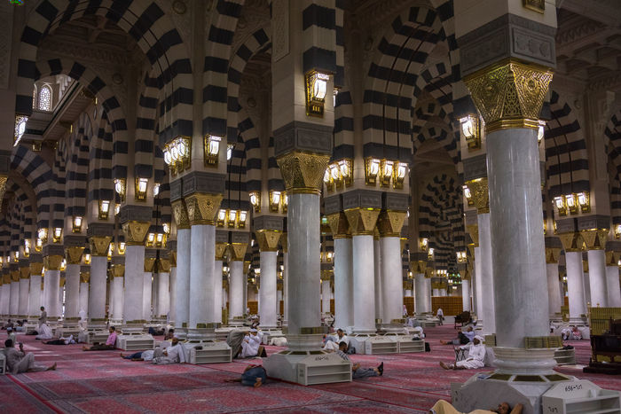 MEDINA, SAUDI ARABIA - 15TH NOV 2017; Internal view of Mosque Al-Nabawi in Medina, Saudi Arabia. It is the second-holiest site in Islam and the mosque was built by Prophet Muhammad in 622 Caligraphy Faith Medina Al Munawarah Nabawi Mosque Pray Arabic Architectural Column Architecture Building Exterior Built Structure City Illuminated Indoors  Muslim Night Pilgrim Pillar