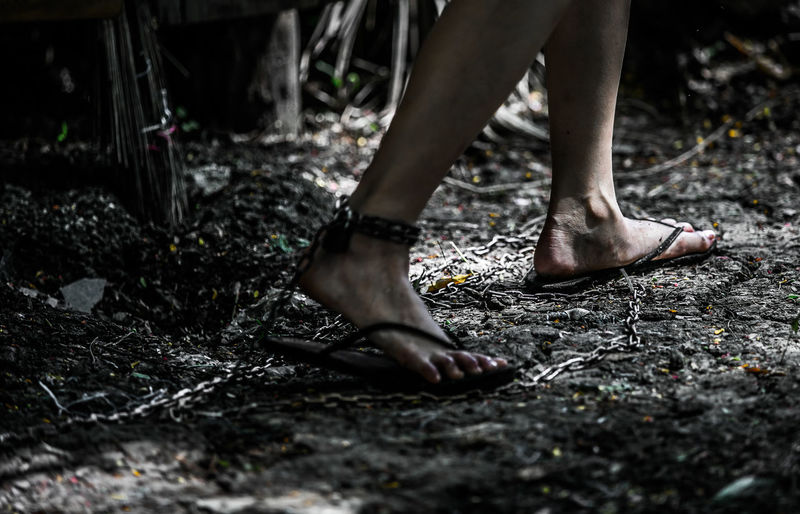 Woman's feet tied to chains. Because she was hurt barefoot Nature Real People Day Standing Outdoors Forest Dirt Plant Land Messy Lifestyles Body Part Selective Focus One Person Human Foot Leisure Activity Human Leg Low Section Human Body Part Human Limb Imprisoned Sandals Attack Severekçekiyoruz Chain