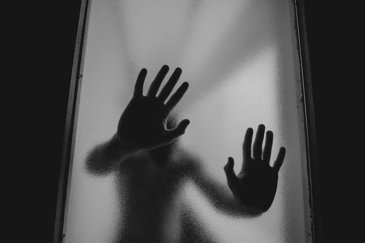 Human Hand Human Body Part Glass - Material Hand One Person Transparent Indoors  Touching Unrecognizable Person Trapped Shadow Window Body Part Mystery Frosted Glass Real People Dark Silhouette Finger Depression - Sadness Aggression  Human Limb