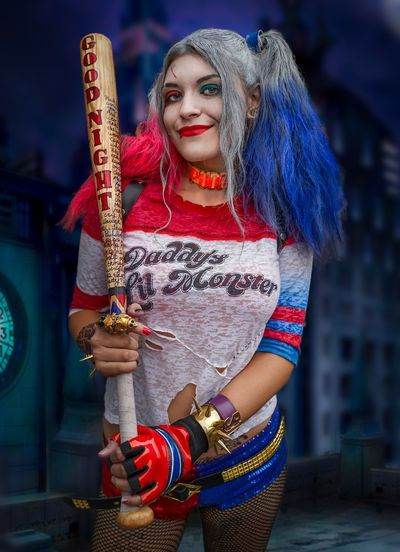 Harley Quinn Cosplayer Cosplay Nycc2018 NYCC SuicideSquad Harleyquinn Real People One Person Front View Holding Standing Young Adult Clothing Focus On Foreground Young Women Women Costume Three Quarter Length Hairstyle Beautiful Woman Long Hair