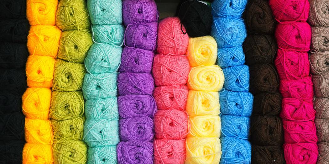 Full Frame Shot Of Multi Colored Woolen Balls For Sale In Shop