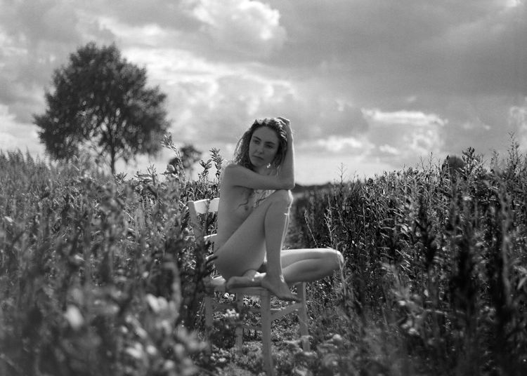 Plant One Person Portrait Field Real People Land Sky Young Adult Women Nature Growth Leisure Activity Looking At Camera Lifestyles Young Women Cloud - Sky Selective Focus Adult Outdoors Beautiful Woman Analogue Photography Medium Format