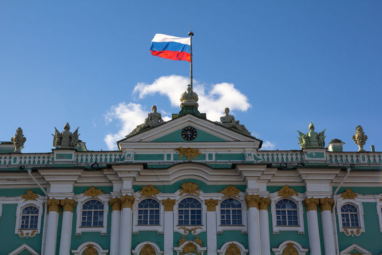 Low angle view of flag on building against sky