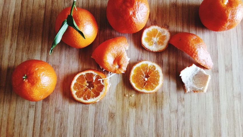 The orange fruit is on a wooden background. EyeEm Selects Fruit Orange - Fruit Healthy Eating Citrus Fruit Still Life Food And Drink Freshness Blood Orange Table SLICE No People Day Indoors  Food Cross Section Close-up Grapefruit