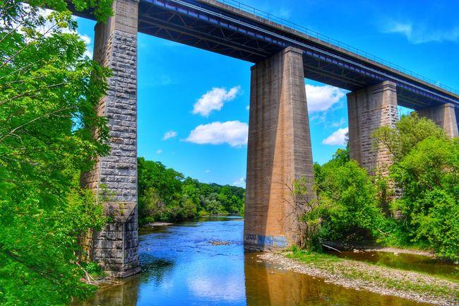 Tree Water City Blue Bridge - Man Made Structure Footbridge River Architectural Column Sky Architecture