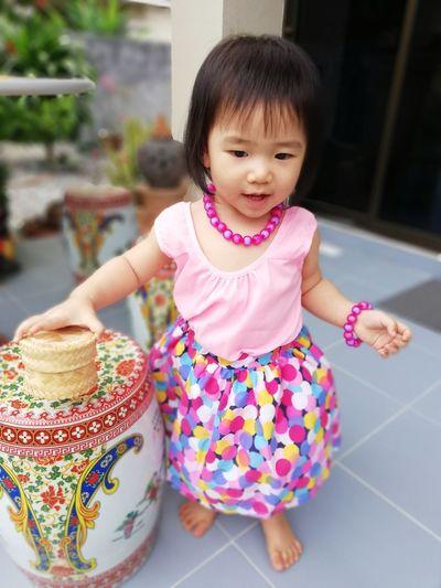 Cute Girl Standing On Tiled Floor
