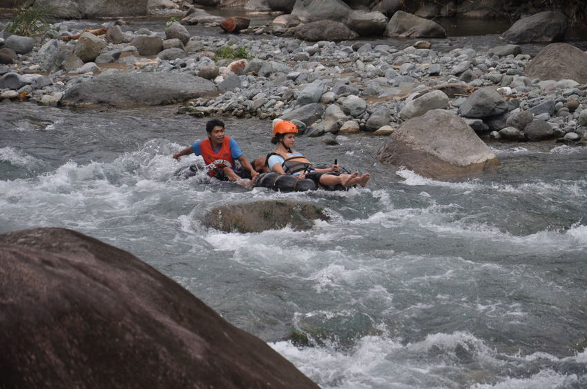 Water tubing in a river. Adventure Leisure Activity Lifestyles Motion Outdoors Power In Nature Real People Recreational Pursuit Vacations Water Weekend Activities