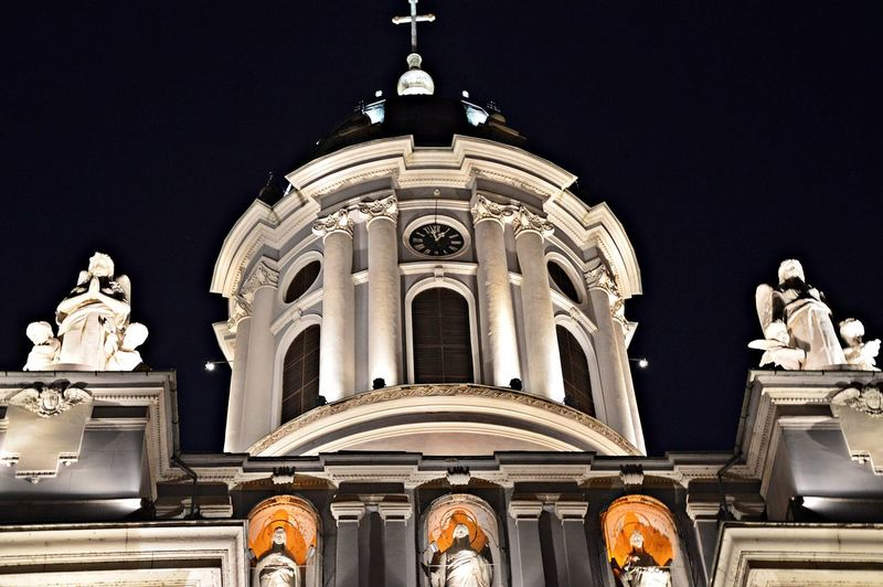 Low angle view of illuminated church against clear sky at night