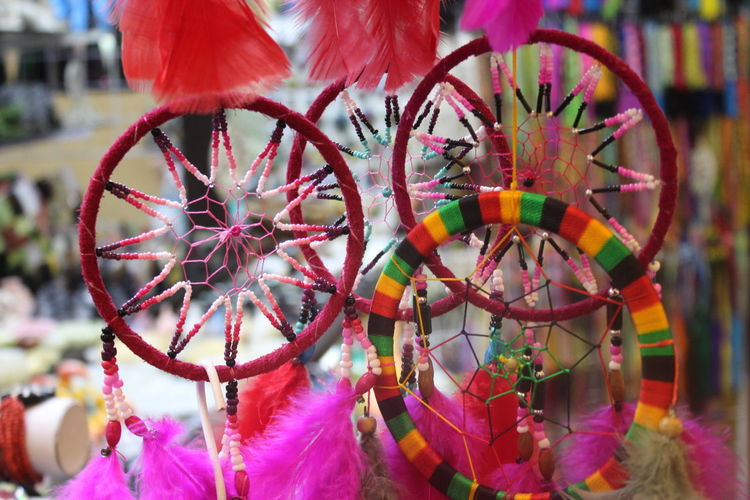Close-up of colorful dreamcatchers hanging at market stall