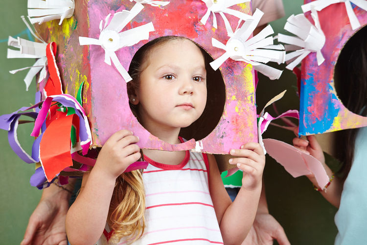 Girl with creative decoration in classroom